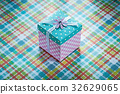 Wrapped gift box on checked fabric background 32629065