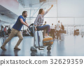 Hilarious smiling couple playing at terminal 32629359