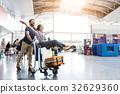 Happy smiling couple having fun at airport 32629360