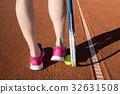 Female legs with tennis racket 32631508