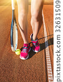 Female legs with tennis racket 32631509