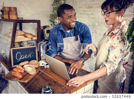 Couple Using Laptop in Bakery Shop 32637449