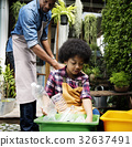 African Descent Kid Separating Recyclable Trash 32637491