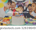 Group of diverse children blowing birthday cake together 32639649