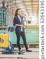 Tourist woman in the airport terminal with luggage 32643395