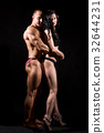 Muscular man and a woman posing in studio  32644231