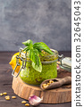 Jar of basil pesto 32645043