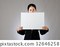 Businesswoman keep silence using a banner 32646258