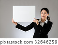 Scared woman holding board with sad face 32646259