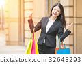 Shopper woman in city shopping having fun 32648293