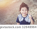 Cute Asian baby Smiling in garden. 32648964