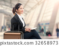 business traveler waiting with airport background 32658973