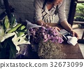Business of flower shop with woman owner 32673099