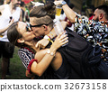 Woman Kissing Man in Live Music Concert Festival 32673158
