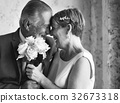 Senior Couple with White Roses Flower Bouqet 32673318