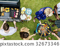 Group of diverse friends grilling barbecue outdoors 32673346