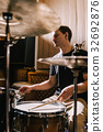 Man drummer playing drums in recording studio 32692876