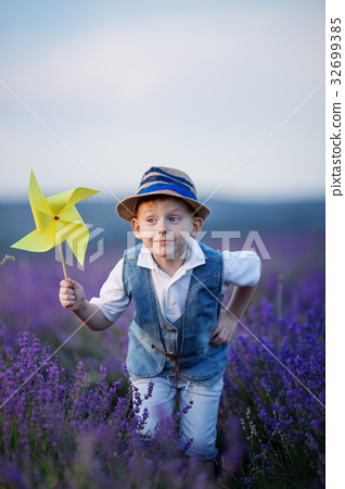 Happy fashion boy in lavender summer field with 32699385