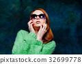 beautiful redhead woman in sunglasses 32699778