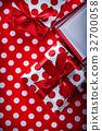 Set of gift boxes on polka-dot red print 32700058