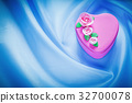 Pink gift box on blue fabric background 32700078