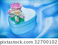 Present box on blue fabric background holidays 32700102