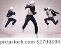 Handsome young b-boy dancing breakdance 32700394