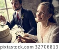 Bride and Groom Cling Wineglasses with Friends on Wedding Recept 32706813