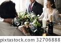 Bride and Groom Having Meal with Friends at Wedding Reception 32706888