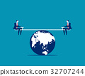 Businessman balanced on seesaw over globe. 32707244