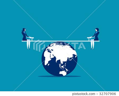 Businesswomen balanced on seesaw over globe. 32707906