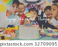 Group of diverse children blowing birthday cake together 32709095