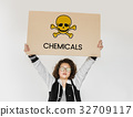 People holding placard with skull icon and chemicals dangerous 32709117