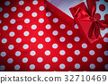 Opened gift box on polka-dot red fabric 32710469
