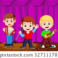 Children in band playing on stage 32711178