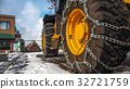 Tractor tires with chains in the snow. 32721759