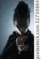 Portrait of female vampire on a dark background 32730864
