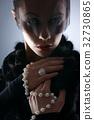 Portrait of female vampire on a dark background 32730865