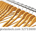 Wooden coat hangers on clothes rail 32733600