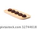 chocolate daifuku on wooden plate 32744618