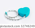 Measuring tape in heart roll isolated on white bac 32746249