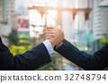 Close up of two businessman press hands each other 32748794