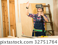 Carpenter working  with vr headset device 32751764