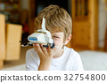 Happy little kid boy playing with space shuttle 32754800