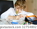 Tired kid boy at home making homework writing 32754802