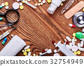 Medicines and tools on wood. 32754949