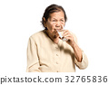 portrait of a senior woman drinking water. 32765836
