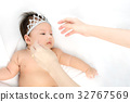 Portrait of adorable baby girl with crown 32767569