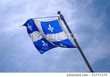 national Quebec flag in Canada fluttering blue sky 32775374