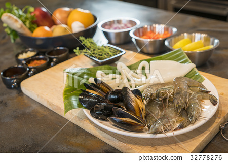 Raw seafood on plate with fruits and vegetables 32778276